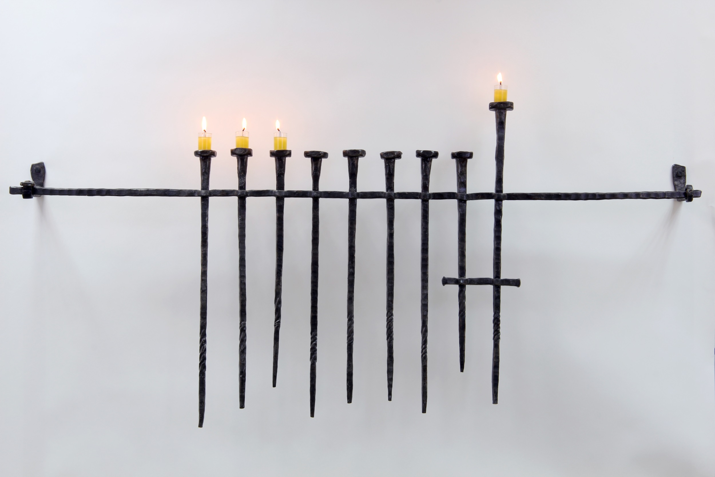 'Stake Hanukkah Menorah' – Iron Menorah of Hanging Stakes