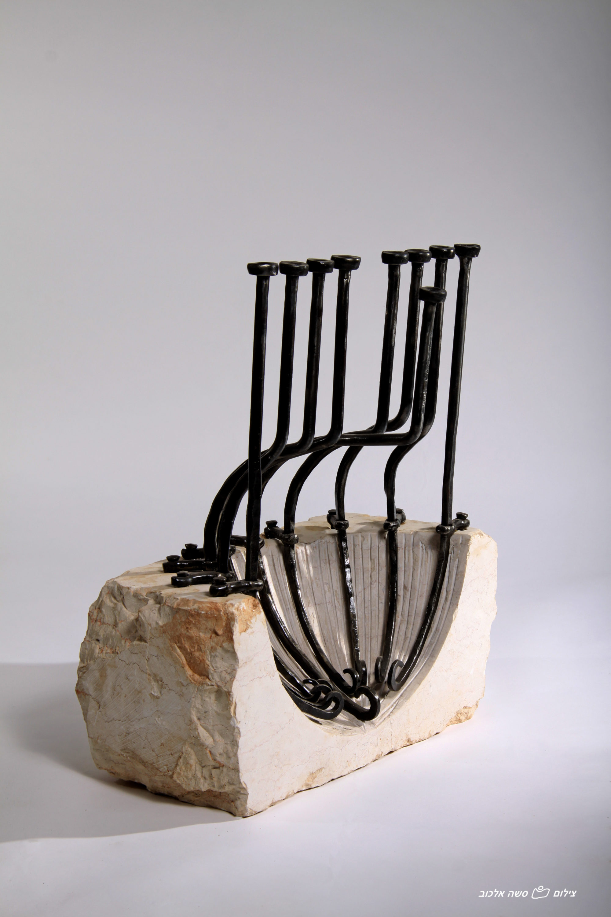 'Shell' - Shell-shaped Hanucka Menorah of Iron & Jerusalem stone