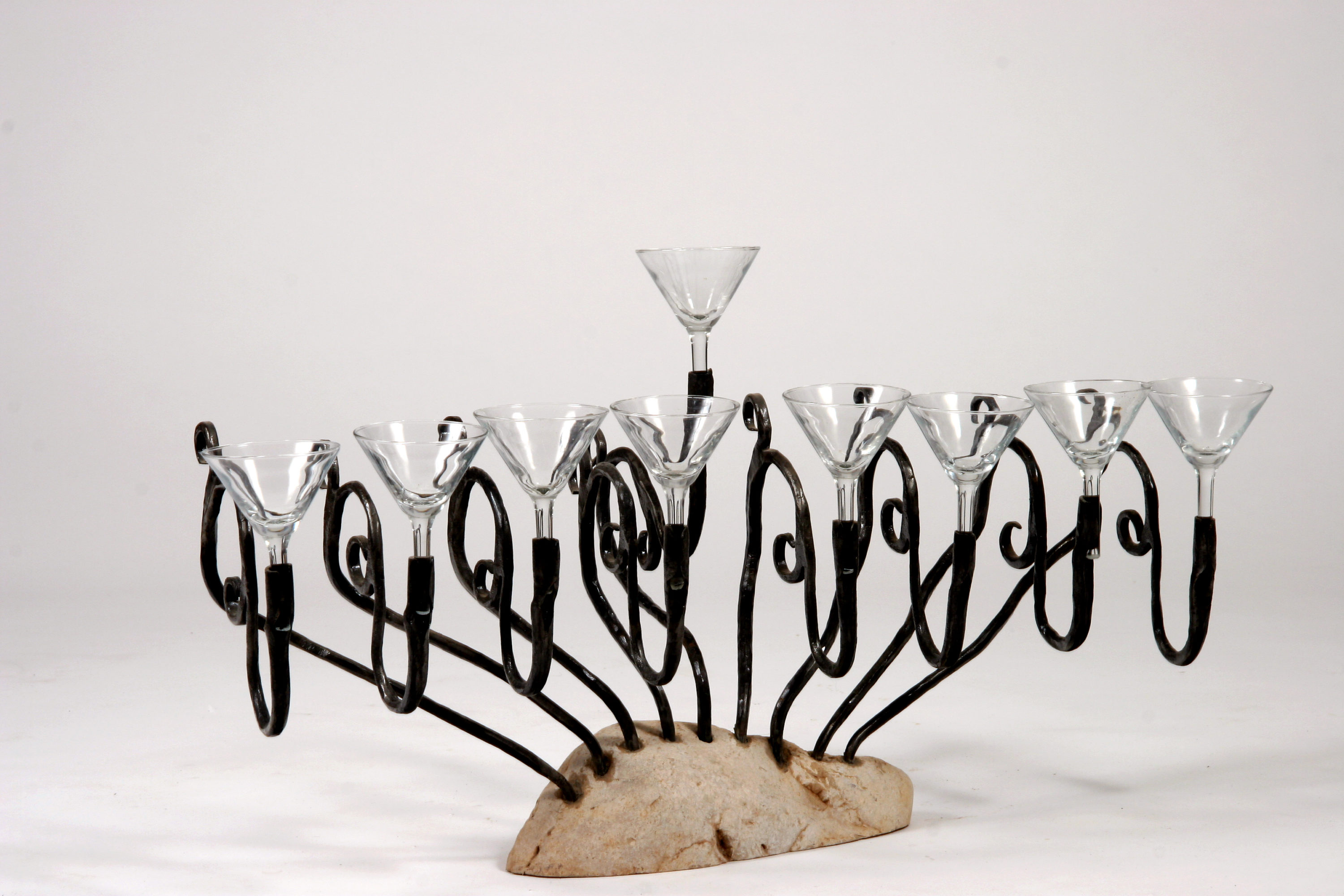 'Glasses' - Menorah of Stone, Iron & Glass – with floating candles in water