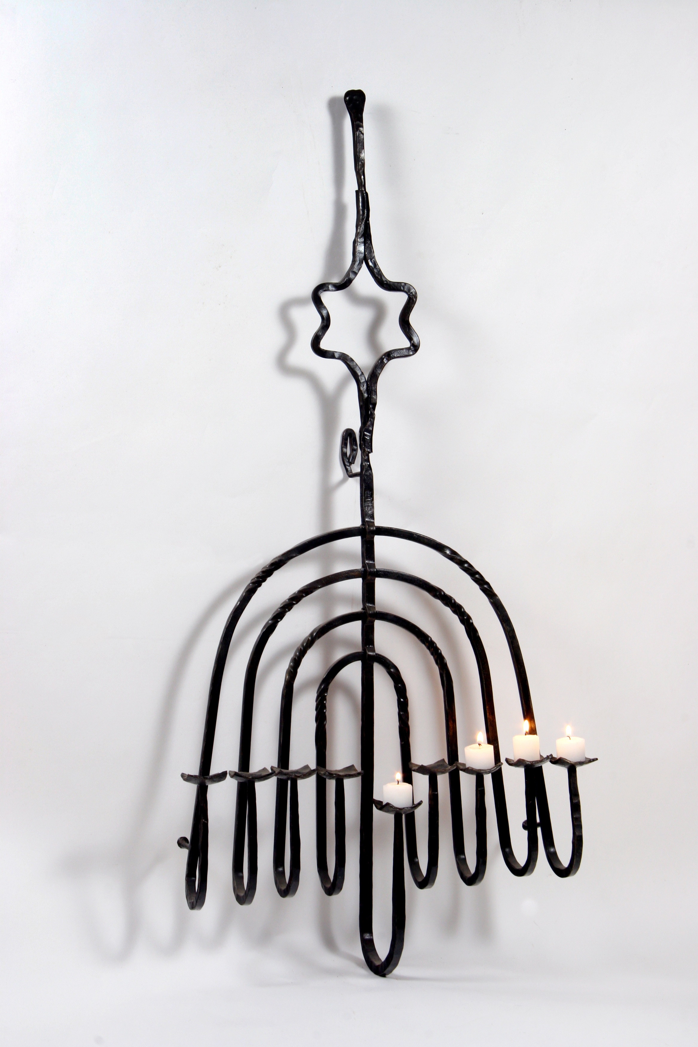 'Upside-down Hanukah menorah' - Hanging Hanucka Menorah of Forged Iron