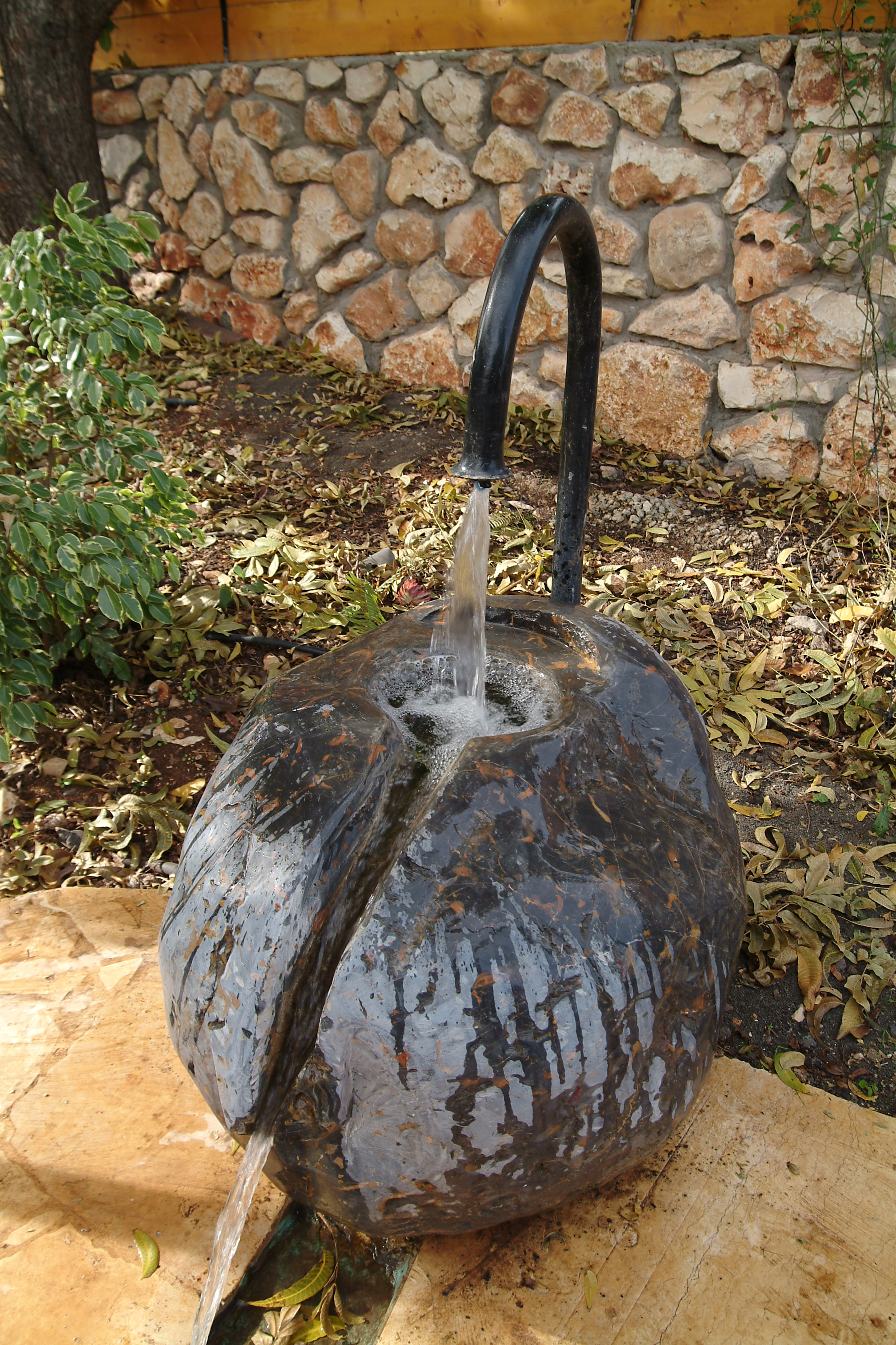 Water Fountain In The Garden – sculpted from a large stone from Mt. Hermon