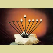 Menorah in Magen David of stone and iron